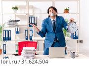 Купить «Young male employee with tape on the mouth», фото № 31624504, снято 13 декабря 2018 г. (c) Elnur / Фотобанк Лори