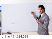 Купить «Young handsome businessman in front of whiteboard», фото № 31624588, снято 10 октября 2018 г. (c) Elnur / Фотобанк Лори