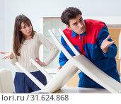 Купить «Contractor repairman assembling furniture under woman supervisio», фото № 31624868, снято 30 ноября 2017 г. (c) Elnur / Фотобанк Лори