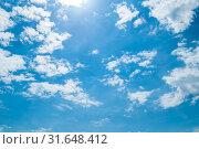 Купить «Небесный пейзаж. Blue dramatic sky background - white dramatic colorful clouds lit by sunlight. Vast sky landscape panoramic scene», фото № 31648412, снято 24 мая 2019 г. (c) Зезелина Марина / Фотобанк Лори