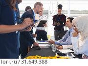 Купить «Business people checking in at conference registration table», фото № 31649388, снято 16 марта 2019 г. (c) Wavebreak Media / Фотобанк Лори
