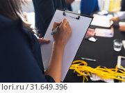 Купить «Businesswoman checking in at conference registration table», фото № 31649396, снято 16 марта 2019 г. (c) Wavebreak Media / Фотобанк Лори