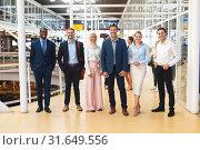 Купить «Business people standing together in corridor at office», фото № 31649556, снято 16 марта 2019 г. (c) Wavebreak Media / Фотобанк Лори