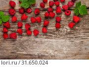 Купить «Ripe raspberry on an old wooden table.», фото № 31650024, снято 30 июня 2019 г. (c) Елена Блохина / Фотобанк Лори