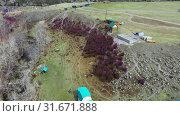 Купить «River bank with rhododendron bushes at the beginning of flowering near camp site on Altai.», видеоролик № 31671888, снято 3 июня 2019 г. (c) Serg Zastavkin / Фотобанк Лори