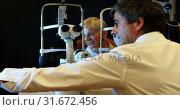 Купить «Optometrist explaining eyesight report on screen 4k», видеоролик № 31672456, снято 10 августа 2018 г. (c) Wavebreak Media / Фотобанк Лори