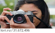 Купить «Woman clicking photo with digital camera 4k», видеоролик № 31672496, снято 23 августа 2018 г. (c) Wavebreak Media / Фотобанк Лори