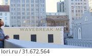 Купить «Businesswoman standing in balcony at office 4k», видеоролик № 31672564, снято 29 августа 2018 г. (c) Wavebreak Media / Фотобанк Лори
