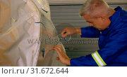 Engineer marking a line on airplane parts 4k. Стоковое видео, агентство Wavebreak Media / Фотобанк Лори