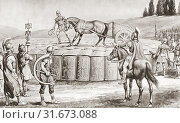 Купить «A Roman military exercise in the days of Julius Caesar, testing the Testudo - a military chariot being driven onto the roof of a Testudo or Tortoise formation...», фото № 31673088, снято 22 мая 2019 г. (c) age Fotostock / Фотобанк Лори