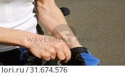 Купить «Senior cyclist wearing fingerless gloves at countryside 4k», видеоролик № 31674576, снято 21 августа 2018 г. (c) Wavebreak Media / Фотобанк Лори
