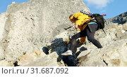 Купить «Senior woman climbing down at countryside 4k», видеоролик № 31687092, снято 21 августа 2018 г. (c) Wavebreak Media / Фотобанк Лори