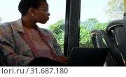 Купить «Commuter looking through window while using laptop in the bus 4k», видеоролик № 31687180, снято 10 июня 2018 г. (c) Wavebreak Media / Фотобанк Лори