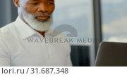 Купить «Male executive working at desk in the office 4k», видеоролик № 31687348, снято 1 сентября 2018 г. (c) Wavebreak Media / Фотобанк Лори