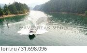 Купить «Man wakeboarding with motorboat in the river 4k», видеоролик № 31698096, снято 22 августа 2018 г. (c) Wavebreak Media / Фотобанк Лори