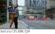 Купить «Couple kissing each other in the city 4k», видеоролик № 31698124, снято 2 августа 2018 г. (c) Wavebreak Media / Фотобанк Лори