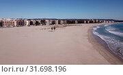 Купить «Aerial view of small Mediterranean coastal town of Torredembarra in Catalonia, Spain», видеоролик № 31698196, снято 18 марта 2019 г. (c) Яков Филимонов / Фотобанк Лори
