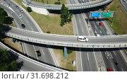 Купить «Aerial view of highway grade separation in Barcelona, Spain», видеоролик № 31698212, снято 12 июня 2018 г. (c) Яков Филимонов / Фотобанк Лори