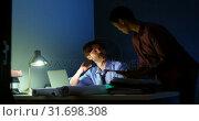 Купить «Executives discussing over laptop at desk 4k», видеоролик № 31698308, снято 5 сентября 2018 г. (c) Wavebreak Media / Фотобанк Лори