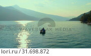 Купить «Tourists fishing on a boat in river 4k», видеоролик № 31698872, снято 30 июля 2018 г. (c) Wavebreak Media / Фотобанк Лори