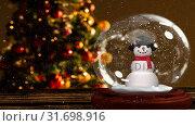 Купить «Cute Christmas animation of snowman against Christmas tree 4k», видеоролик № 31698916, снято 26 октября 2018 г. (c) Wavebreak Media / Фотобанк Лори