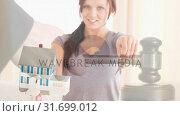 Купить «Digital animation of female real estate agent holding the house key 4k», видеоролик № 31699012, снято 26 октября 2018 г. (c) Wavebreak Media / Фотобанк Лори
