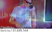 Купить «Digital animation showing smiling disco jockey mixing music in pub 4k», видеоролик № 31699164, снято 26 октября 2018 г. (c) Wavebreak Media / Фотобанк Лори