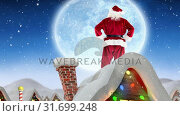 Купить «Santa clause on rooftop of a decorated house combined with falling snow», видеоролик № 31699248, снято 2 ноября 2018 г. (c) Wavebreak Media / Фотобанк Лори