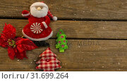 Купить «Falling snow with Christmas Santa decoration», видеоролик № 31699264, снято 2 ноября 2018 г. (c) Wavebreak Media / Фотобанк Лори