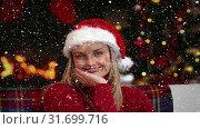 Купить «Video composition with falling snow over happy girl in santas suit sitting at couch in room with fir», видеоролик № 31699716, снято 2 ноября 2018 г. (c) Wavebreak Media / Фотобанк Лори