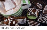 Купить «Falling snow with Christmas cookies decoration», видеоролик № 31700084, снято 2 ноября 2018 г. (c) Wavebreak Media / Фотобанк Лори