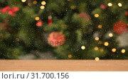 Купить «Falling snow and Christmas lights decorations», видеоролик № 31700156, снято 2 ноября 2018 г. (c) Wavebreak Media / Фотобанк Лори