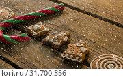 Купить «Falling snow with Christmas sweets decorations», видеоролик № 31700356, снято 2 ноября 2018 г. (c) Wavebreak Media / Фотобанк Лори