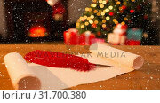 Купить «Falling snow and Santa list at Christmas home», видеоролик № 31700380, снято 2 ноября 2018 г. (c) Wavebreak Media / Фотобанк Лори