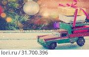 Купить «Model car with presents and blurred background of a christmas tree combined with falling snow», видеоролик № 31700396, снято 2 ноября 2018 г. (c) Wavebreak Media / Фотобанк Лори