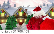 Купить «Santa clause in front of decorated houses in winter scenery combined with falling snow», видеоролик № 31700408, снято 2 ноября 2018 г. (c) Wavebreak Media / Фотобанк Лори