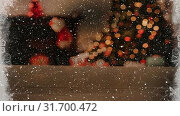 Купить «Video composition with snow over room  with Christmas decorations viewed through icy window», видеоролик № 31700472, снято 2 ноября 2018 г. (c) Wavebreak Media / Фотобанк Лори