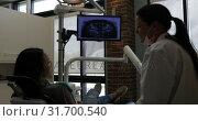 Купить «Female dentist interacting with a patient 4k», видеоролик № 31700540, снято 5 августа 2018 г. (c) Wavebreak Media / Фотобанк Лори