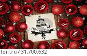 Купить «Falling snow and Merry Christmas text note and bauble decorations on wood», видеоролик № 31700632, снято 2 ноября 2018 г. (c) Wavebreak Media / Фотобанк Лори
