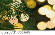 Купить «Falling snow and Christmas tree with lights», видеоролик № 31700640, снято 2 ноября 2018 г. (c) Wavebreak Media / Фотобанк Лори
