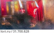 Купить «Candles and christmas decoration combined with falling snow», видеоролик № 31700828, снято 2 ноября 2018 г. (c) Wavebreak Media / Фотобанк Лори