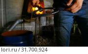 Купить «Metalsmith removing horseshoe from water 4k», видеоролик № 31700924, снято 15 сентября 2018 г. (c) Wavebreak Media / Фотобанк Лори
