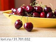 Купить «Red sweet cherry on a table», фото № 31701032, снято 25 июня 2019 г. (c) Юлия Бабкина / Фотобанк Лори