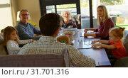 Купить «Multi-generation family interacting with each other on dining table 4k», видеоролик № 31701316, снято 30 августа 2018 г. (c) Wavebreak Media / Фотобанк Лори