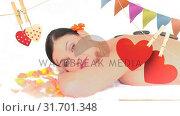 Купить «Woman lying down with massage stones on her back», видеоролик № 31701348, снято 6 ноября 2018 г. (c) Wavebreak Media / Фотобанк Лори