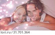 Купить «Happy couple in bed, smiling at camera», видеоролик № 31701364, снято 6 ноября 2018 г. (c) Wavebreak Media / Фотобанк Лори