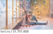 Купить «Digital animation of upset male student sitting in corridor 4k», видеоролик № 31701808, снято 12 ноября 2018 г. (c) Wavebreak Media / Фотобанк Лори