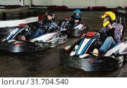 Купить «People driving go-kart cars», фото № 31704540, снято 22 октября 2019 г. (c) Яков Филимонов / Фотобанк Лори