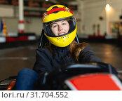 Купить «woman with helmet sitting in car for motor racing», фото № 31704552, снято 18 марта 2019 г. (c) Яков Филимонов / Фотобанк Лори