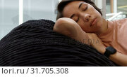 Купить «Businesswoman sleeping on sofa in modern office 4k», видеоролик № 31705308, снято 10 января 2019 г. (c) Wavebreak Media / Фотобанк Лори